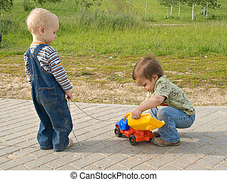 Children with a toy truck