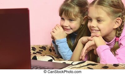 Children with a variety of emotions fun look at the laptop screen