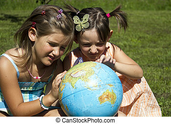 Children with earth globe