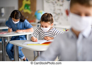 Children with face mask back at school after covid-19 ...
