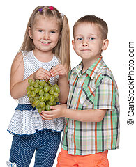 Children with grapes