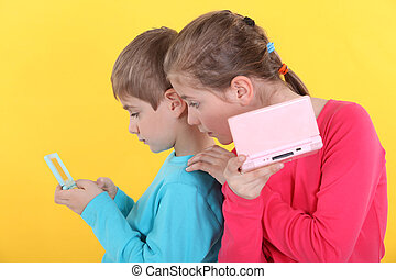 Children with handheld computer games