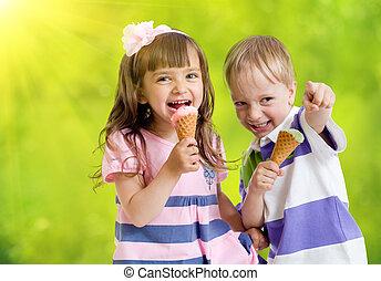 Children with icecream cone outdoor in hot summer day
