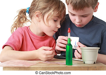 Children with interest make craft out of different materials...