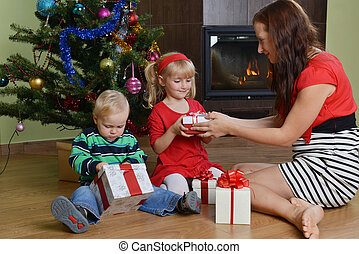 children with mother - happy children with mother sitting...