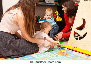 Children with mothers in the playroom