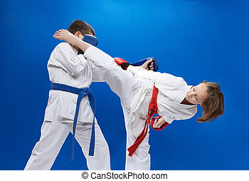 Children with overlays on the hands are training strikes and blocks