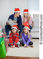 Children With Parents At Home During Christmas