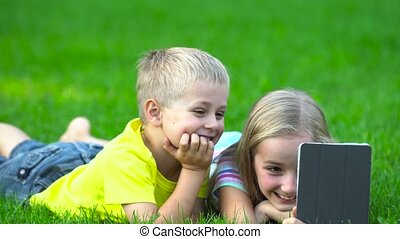 children with smart phone ooutside - children plaing with ...