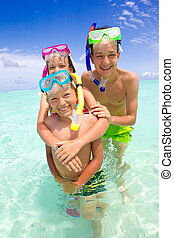 Children with snorkels in sea