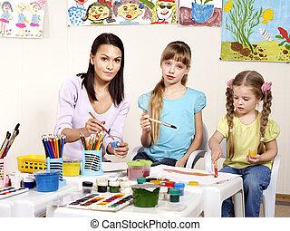 Children with teacher in school.