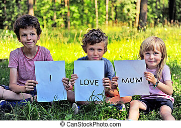 Children with the sign I love mum