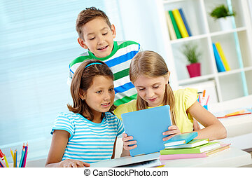 Children with touchpad - Portrait of astonished classmates...