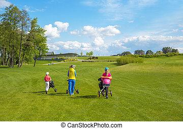 Children with trainer at golf