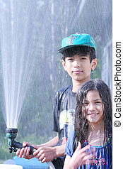 Children with water hose