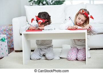 Children Writing Letter To Santa Claus During Christmas - ...
