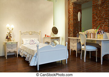 Children\\\'s bed and table in a modern bedroom