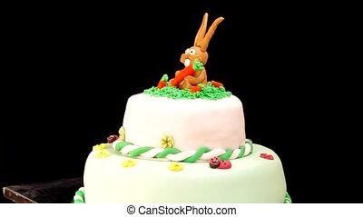 Children's birthday cake on black background