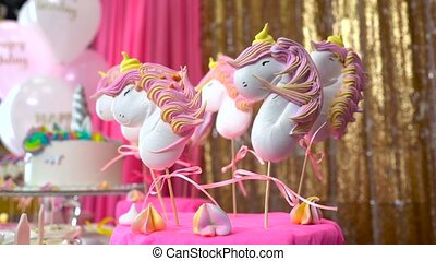 Children's birthday party. Unicorn themed treats, against...