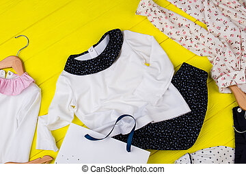 Children's clothes on yellow table