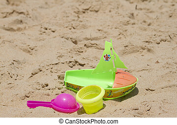 Children's colorful sandy toys on beautiful a beach. India...