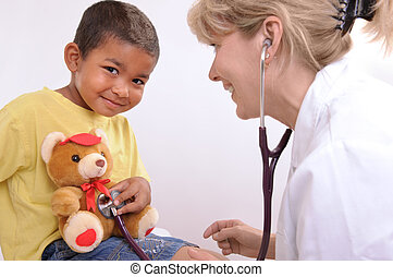childrens doctor - female doctor playing with a child
