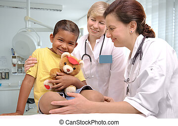 childrens doctors - two female doctors examining little...