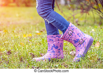 children's feet in rubber boots