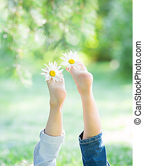 Children`s feet with flowers
