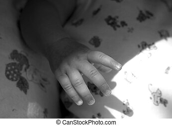 Children's hand - The image of a children's hand. Black-and-...