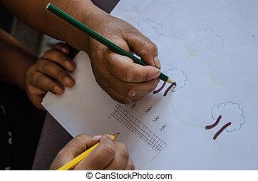 Children's hands drawing