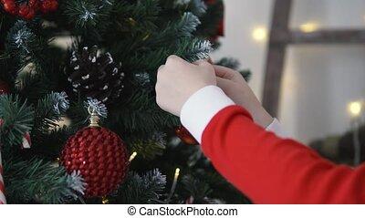 children's hands hang a beautiful ball