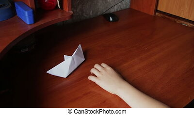 children's hands making origami plane - children's hands do...