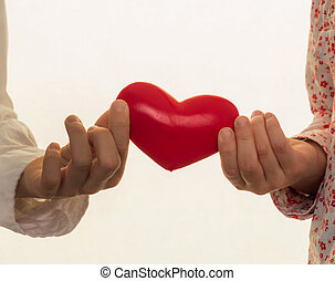 children's hands with heart - two children hands holding a...