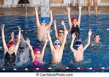 .childrens having fun in a swimming pool