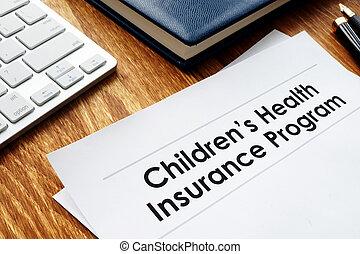 Childrens Health Insurance Program CHIP documents on a desk.