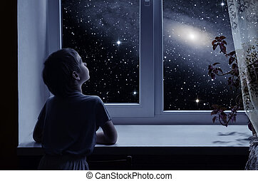 Children's imagination - A little boy is standing near the...