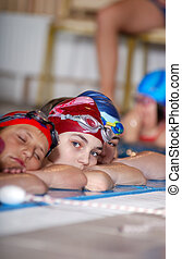 .childrens in serie at swimming pool