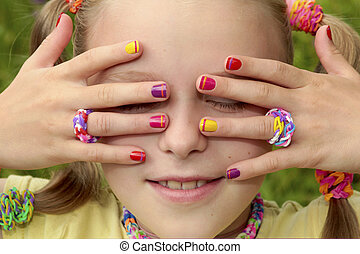 Children's multicolored manicure with stripes on a light...