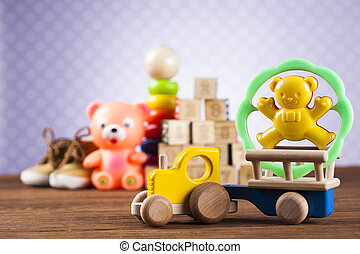 Children's of toy accessories on wooden background