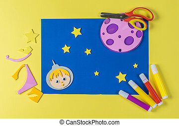 Children's paper crafts on a space theme.