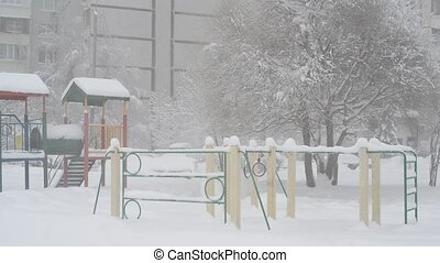 children's play complex near house during blizzards -...