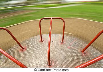 Children's Playground equipment - merry go round spinning very fast