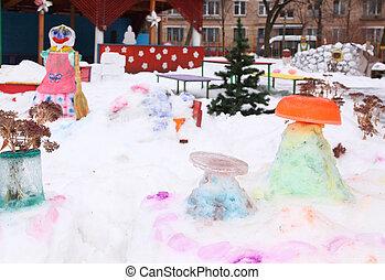 Children\'s playground in court yard in winter