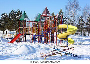 Children\'s playground in winter