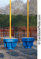 childrens playground obstacles covered in frost