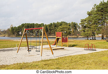 Children's playground s on the bank of lake
