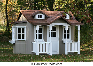 Children's playhouse in backyard country setting.