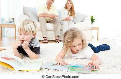 Childrens reading books in the living rooms