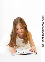 Children\'s reading matter - A smiling little girl lays on a...